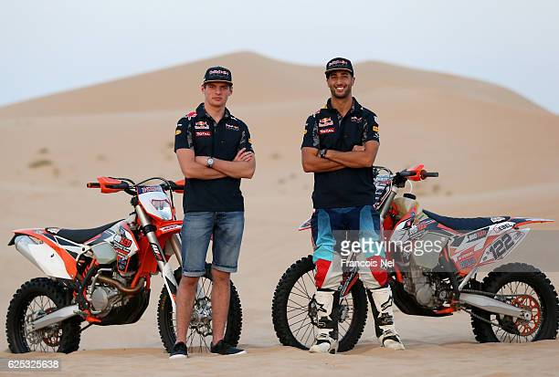 Max Verstappen of Netherlands and Red Bull Racing and Daniel Ricciardo of Australia and Red Bull Racing pose for a photograph during the Red Bull...
