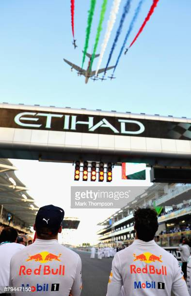 Max Verstappen of Netherlands and Red Bull Racing and Daniel Ricciardo of Australia and Red Bull Racing look on during an aerial display above the...