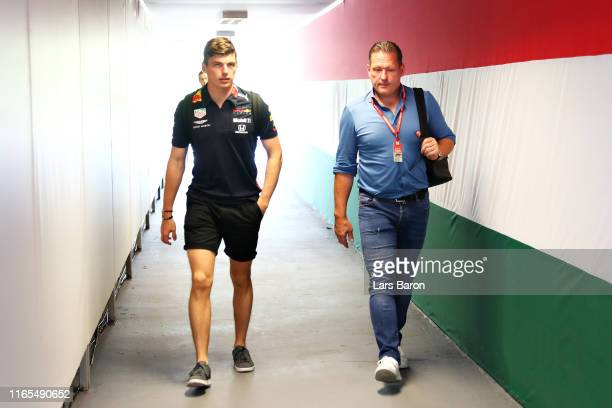 Max Verstappen of Netherlands and Red Bull Racing and father Jos Verstappen walk in the Paddock during previews ahead of the F1 Grand Prix of Hungary...