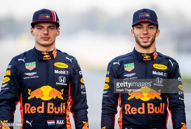 Max Verstappen of Netherlands and Red Bull Racing and Pierre Gasly of France and Red Bull Racing walk on track during Red Bull Racing Filming Day at...