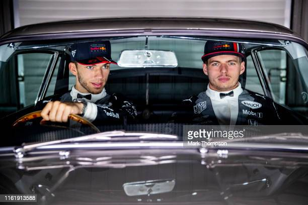 Max Verstappen of Netherlands and Red Bull Racing and Pierre Gasly of France and Red Bull Racing show off their 007 James Bond inspired special...