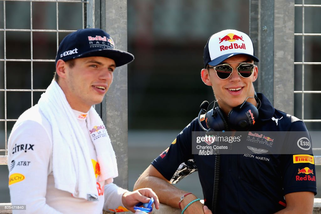Max Verstappen of Netherlands and Red Bull Racing and Pierre Gasly of France and Red Bull Racing look on from the pit wall during day one of F1 in-season testing at Hungaroring on August 1, 2017 in Budapest, Hungary.