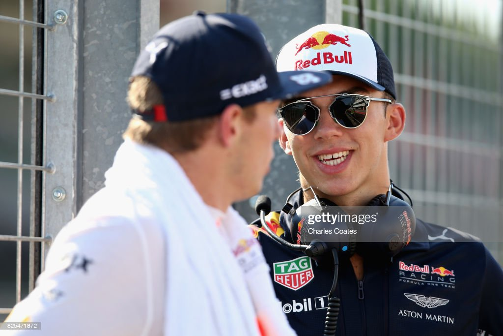 Max Verstappen of Netherlands and Red Bull Racing and Pierre Gasly of France and Red Bull Racing talk on the pit wall during day one of F1 in-season testing at Hungaroring on August 1, 2017 in Budapest, Hungary.