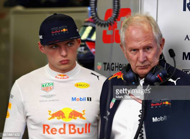 Max Verstappen of Netherlands and Red Bull Racing and Red Bull Racing Team Consultant Dr Helmut Marko look on in the garage during practice for the...