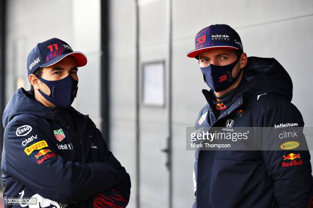 Max Verstappen of Netherlands and Red Bull Racing and Sergio Perez of Mexico and Red Bull Racing talk in the Pitlane during the Red Bull Racing...