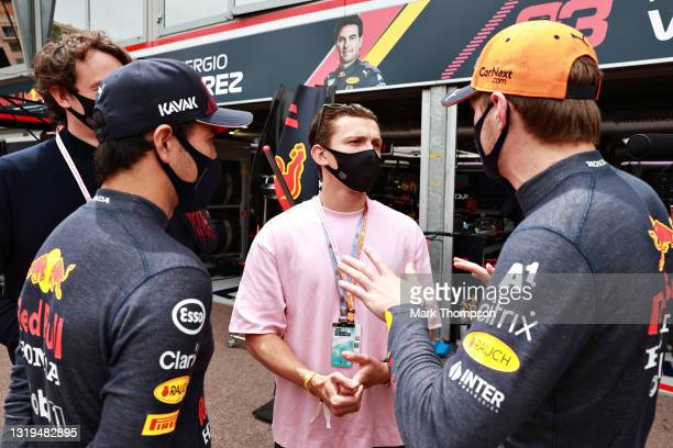 Max Verstappen of Netherlands and Red Bull Racing and Sergio Perez of Mexico and Red Bull Racing talk with actor Tom Holland ahead of final practice...