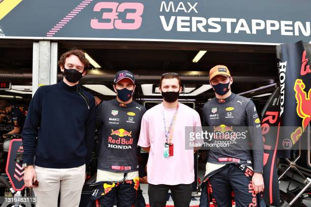 Max Verstappen of Netherlands and Red Bull Racing and Sergio Perez of Mexico and Red Bull Racing pose for a photo with actor Tom Holland and TAG...