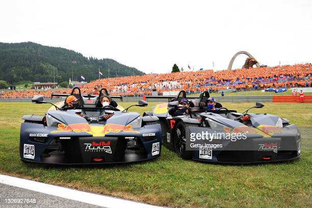 Max Verstappen of Netherlands and Red Bull Racing and Sergio Perez of Mexico and Red Bull Racing stop on track for the drivers parade before the F1...