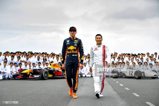 Max Verstappen of Netherlands and Red Bull Racing and Takuma Sato pose for a photo with Honda employees during previews ahead of the F1 Grand Prix of...
