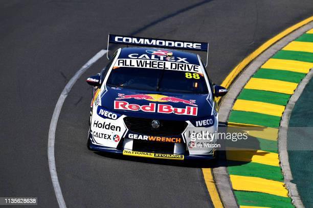 Max Verstappen of Netherlands and Red Bull Racing and V8 Supercars driver Jamie Whincup of Australia drive a lap in the Holden ZB Commodore during...