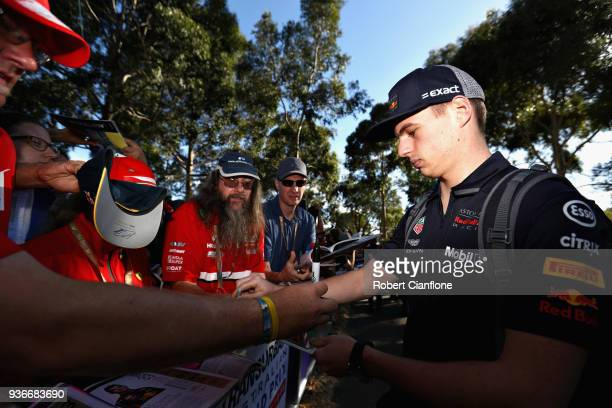 Max Verstappen of Netherlands and Red Bull Racing arrives at the circuit and signs autographs for fans before practice for the Australian Formula One...