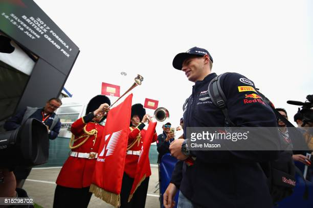 Max Verstappen of Netherlands and Red Bull Racing arrives at the circuit as Queens Guards wearing traditional bearskin hats play horns at the paddock...