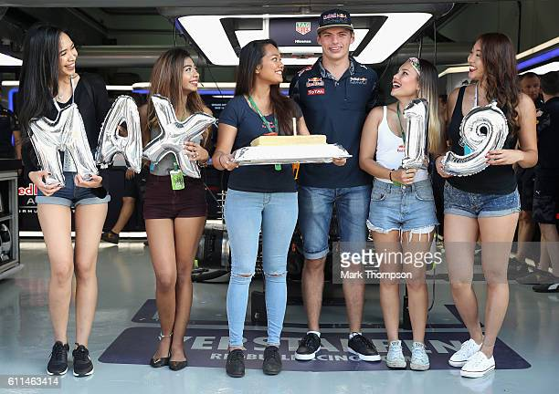 Max Verstappen of Netherlands and Red Bull Racing celebrates his 19th birthday before practice for the Malaysia Formula One Grand Prix at Sepang...