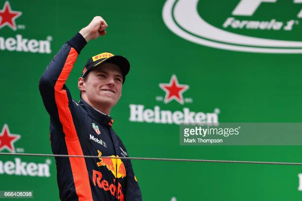 Max Verstappen of Netherlands and Red Bull Racing celebrates his third place position on the podium during the Formula One Grand Prix of China at...