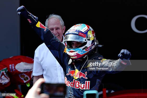 Max Verstappen of Netherlands and Red Bull Racing celebrates his first win in parc ferme with Red Bull Racing Team Consultant Dr Helmut Marko during...