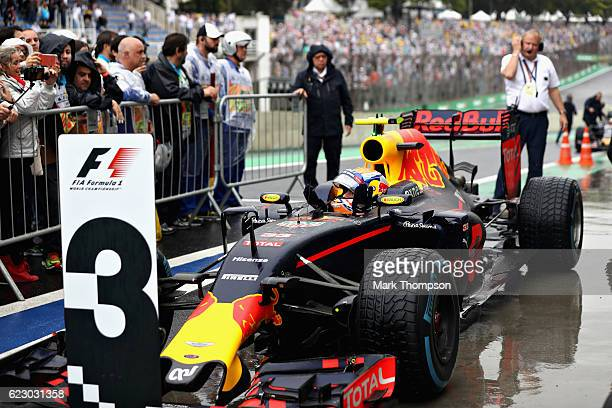 Max Verstappen of Netherlands and Red Bull Racing celebrates finishing in third position in parc ferme during the Formula One Grand Prix of Brazil at...