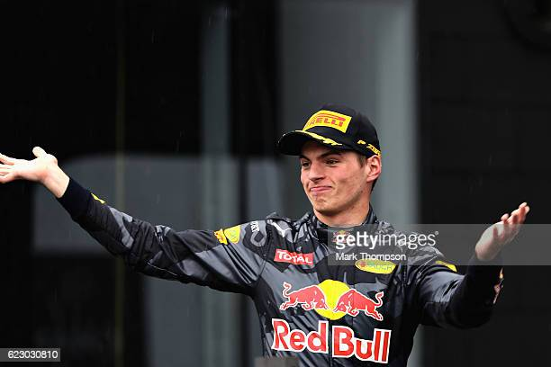Max Verstappen of Netherlands and Red Bull Racing celebrates finishing in third place on the podium during the Formula One Grand Prix of Brazil at...