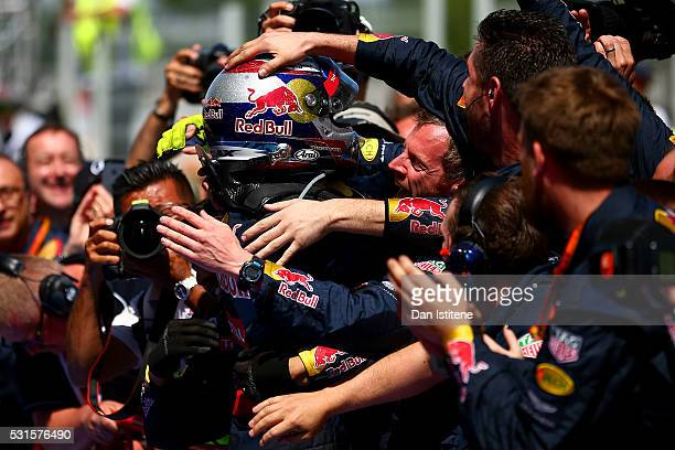 Max Verstappen of Netherlands and Red Bull Racing celebrates in parc ferme with the Red Bull Racing team after his first win during the Spanish...