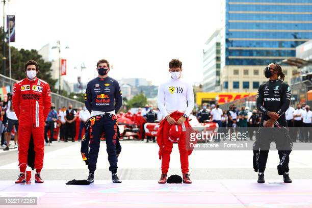 Max Verstappen of Netherlands and Red Bull Racing, Charles Leclerc of Monaco and Ferrari and Lewis Hamilton of Great Britain and Mercedes GP stand...