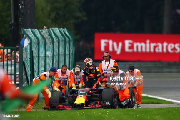 Max Verstappen of Netherlands and Red Bull Racing climbs from his car after retiring during the Formula One Grand Prix of Belgium at Circuit de...