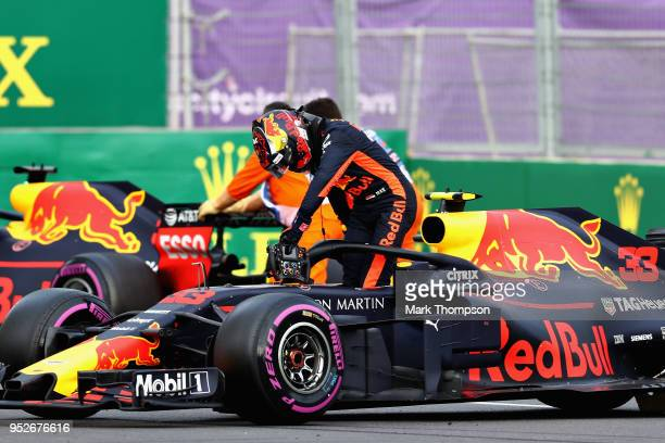 Max Verstappen of Netherlands and Red Bull Racing climbs from his car after retiring during the Azerbaijan Formula One Grand Prix at Baku City...