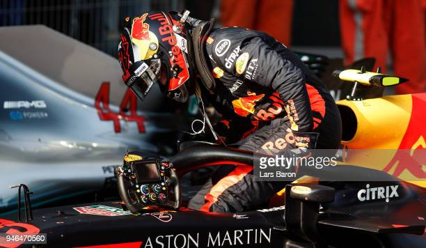 Max Verstappen of Netherlands and Red Bull Racing climbs out of his car in parc ferme during the Formula One Grand Prix of China at Shanghai...