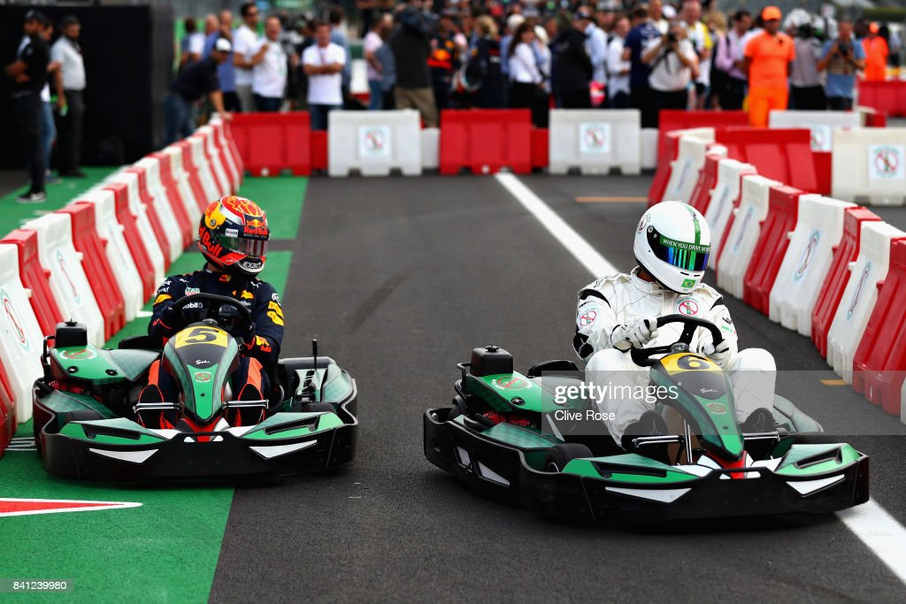 Max Verstappen of Netherlands and Red Bull Racing competes with Dida at a karting event during previews for the Formula One Grand Prix of Italy at Autodromo di Monza on August 31, 2017 in Monza, Italy.