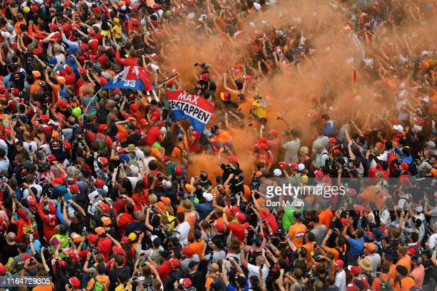 Max Verstappen of Netherlands and Red Bull Racing fans celebrate after the F1 Grand Prix of Germany at Hockenheimring on July 28 2019 in Hockenheim...