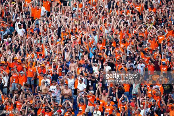 Max Verstappen of Netherlands and Red Bull Racing fans cheer during qualifying for the Formula One Grand Prix of Austria at Red Bull Ring on June 30...