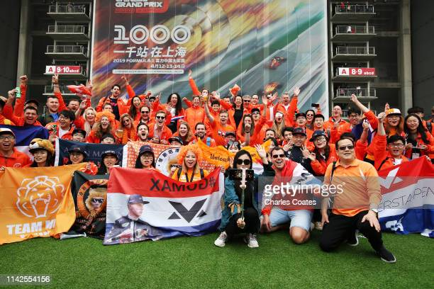 Max Verstappen of Netherlands and Red Bull Racing fans enjoy the atmosphere before the F1 Grand Prix of China at Shanghai International Circuit on...