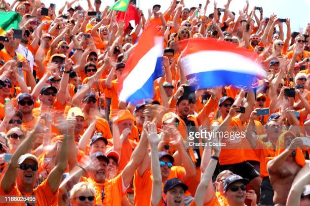Max Verstappen of Netherlands and Red Bull Racing fans show their support before the F1 Grand Prix of Hungary at Hungaroring on August 04 2019 in...