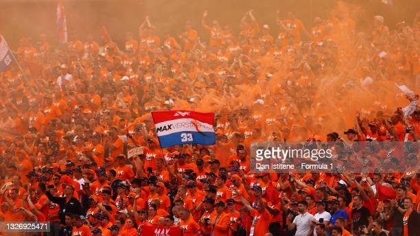 Max Verstappen of Netherlands and Red Bull Racing fans show their support before the F1 Grand Prix of Austria at Red Bull Ring on July 04, 2021 in...