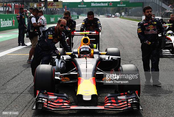 Max Verstappen of Netherlands and Red Bull Racing gets pushed onto the grid by the Red Bull Racing team during the Formula One Grand Prix of Italy at...