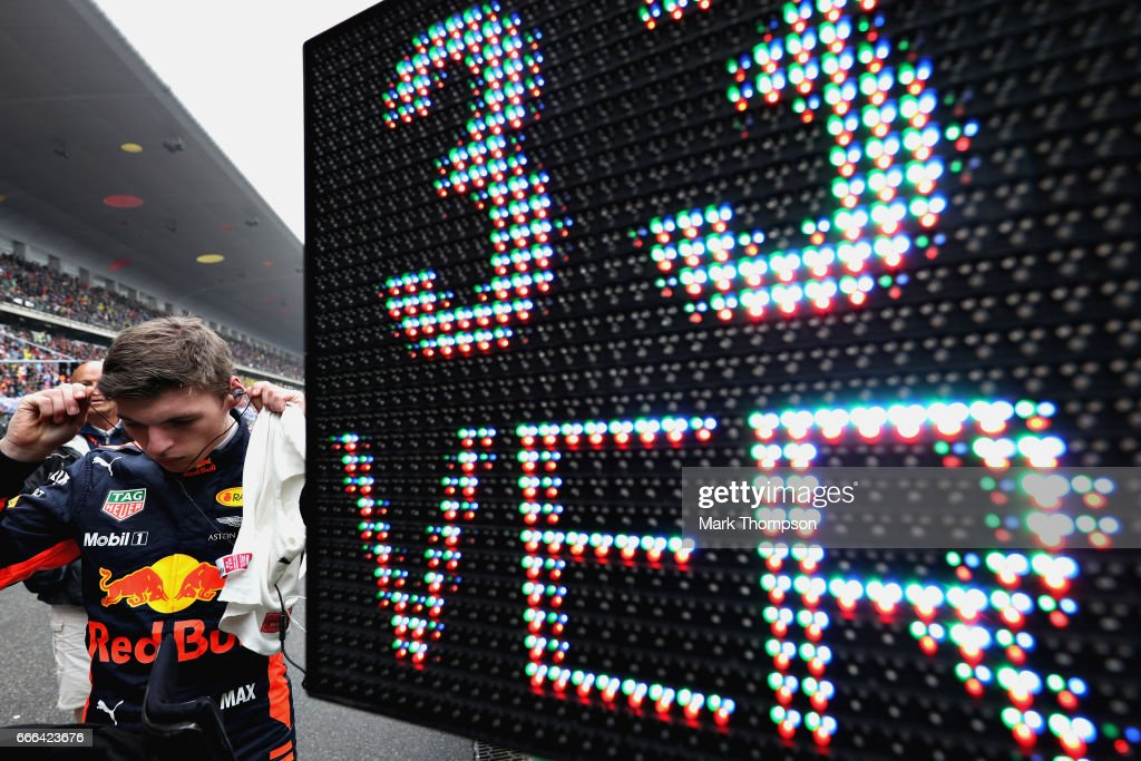 Max Verstappen of Netherlands and Red Bull Racing gets ready to race on the grid during the Formula One Grand Prix of China at Shanghai International Circuit on April 9, 2017 in Shanghai, China.