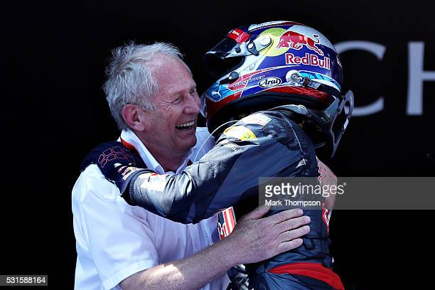 Max Verstappen of Netherlands and Red Bull Racing is congratulated on his first F1 win by Red Bull Racing Team Consultant Dr Helmut Marko in parc...