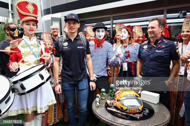 Max Verstappen of Netherlands and Red Bull Racing is greeted as he walks in the Paddock on his 21st birthday before the Formula One Grand Prix of...