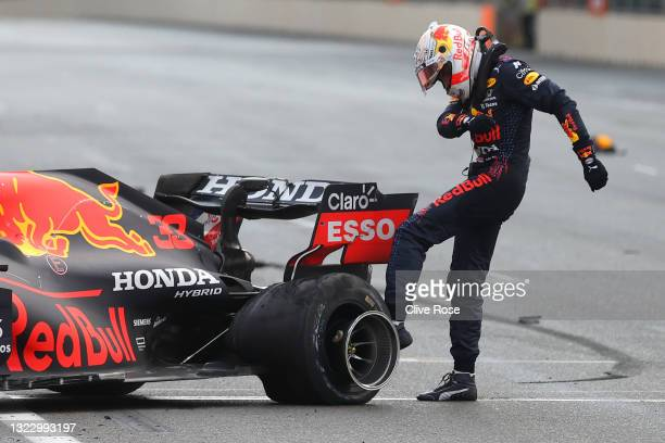 Max Verstappen of Netherlands and Red Bull Racing kicks his tyre as he reacts after crashing during the F1 Grand Prix of Azerbaijan at Baku City...