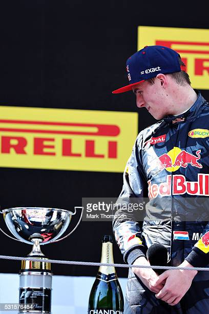 Max Verstappen of Netherlands and Red Bull Racing looks at his trophy on the podium after his first win during the Spanish Formula One Grand Prix at...