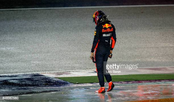 Max Verstappen of Netherlands and Red Bull Racing looks dejected after retiring during the Formula One Grand Prix of Singapore at Marina Bay Street...