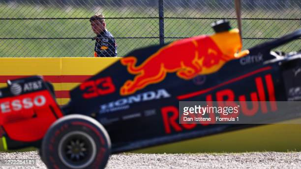 Max Verstappen of Netherlands and Red Bull Racing looks on as his car is removed from the track after a crash during the F1 Grand Prix of Tuscany at...