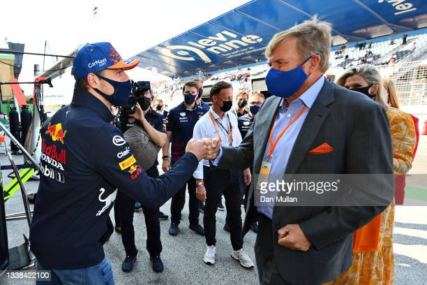 Max Verstappen of Netherlands and Red Bull Racing meets King Willem-Alexander of the Netherlands ahead of the F1 Grand Prix of The Netherlands at...