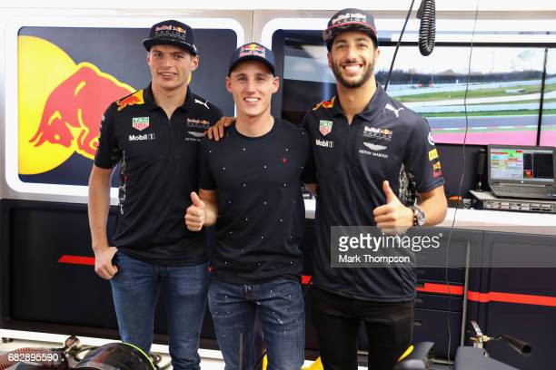 Max Verstappen of Netherlands and Red Bull Racing Moto GP rider Pol Espargaro and Daniel Ricciardo of Australia and Red Bull Racing in the Red Bull...