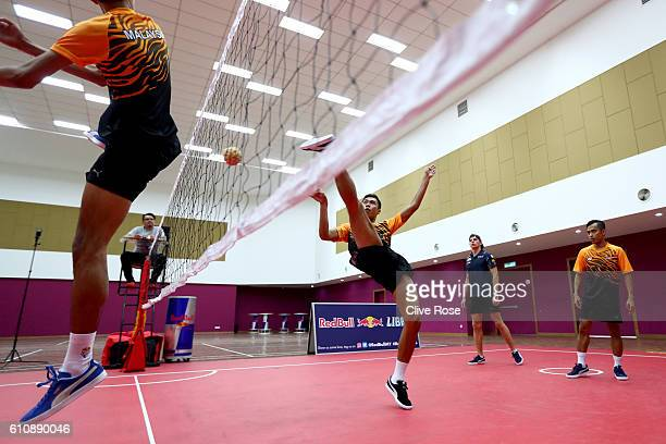 Max Verstappen of Netherlands and Red Bull Racing plays Malaysian sport sepak takraw at the iM4U Sentral in Puchong during previews for the Malaysia...