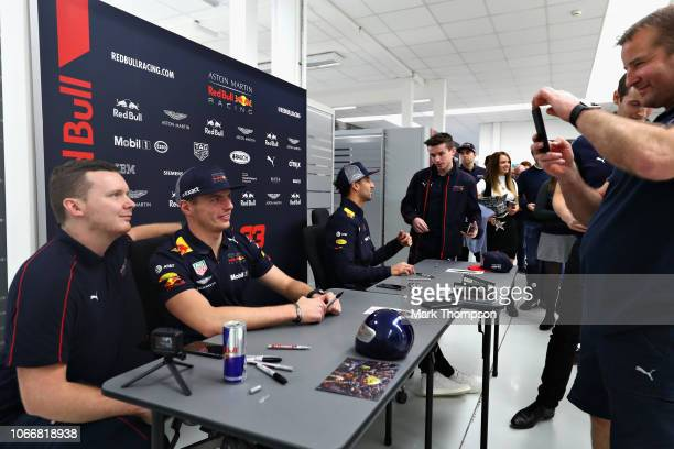 Max Verstappen of Netherlands and Red Bull Racing poses for a photo with a Red Bull Racing team member during the Red Bull Racing Drivers Factory...