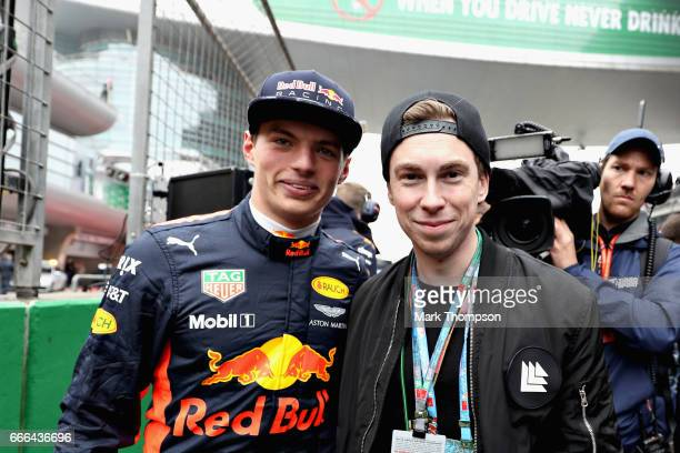 Max Verstappen of Netherlands and Red Bull Racing poses for a photo with Dutch DJ Hardwell on the grid during the Formula One Grand Prix of China at...
