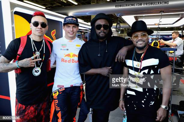 Max Verstappen of Netherlands and Red Bull Racing poses for a photo with the Black Eyed Peas Taboo william and apldeap before qualifying for the...