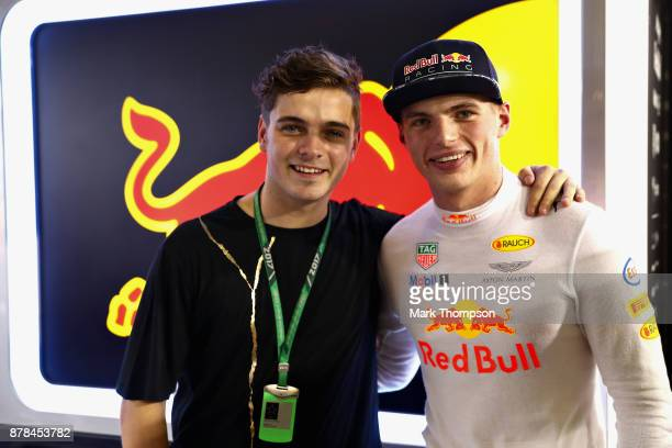 Max Verstappen of Netherlands and Red Bull Racing poses for a photo with superstar DJ Martin Garrix in the Red Bull Racing garage after practice for...