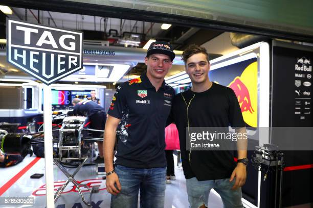 Max Verstappen of Netherlands and Red Bull Racing poses for a photo with superstar DJ Martin Garrix after practice for the Abu Dhabi Formula One...
