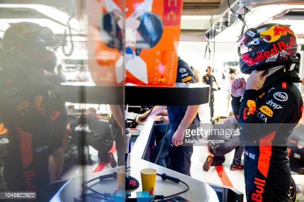 Max Verstappen of Netherlands and Red Bull Racing prepares to drive in the garage during practice for the Formula One Grand Prix of Japan at Suzuka...