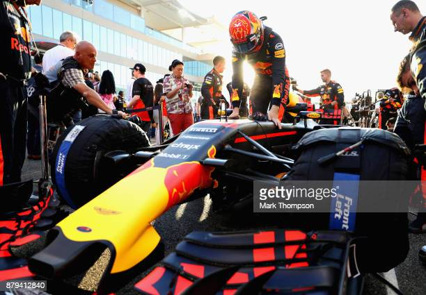 Max Verstappen of Netherlands and Red Bull Racing prepares to drive on the grid before the Abu Dhabi Formula One Grand Prix at Yas Marina Circuit on...